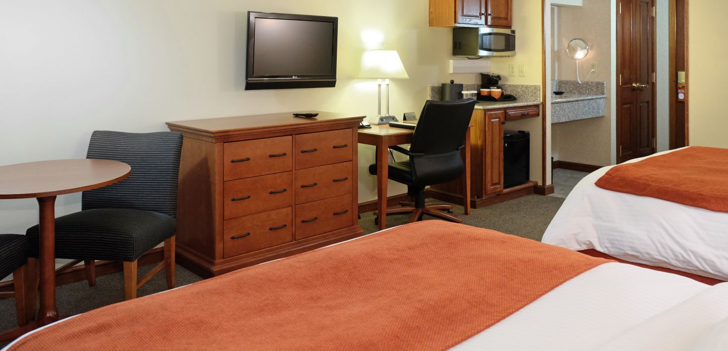 hotel room with table and dresser