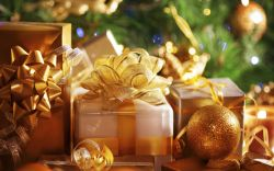 gold presents by the christmas tree
